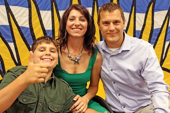 MLA Michelle Stilwell is pictured above on the May 2013 night she won election as MLA for Parksville-Qualicum. With Stilwell is her husband Mark, right, and son Kai.
