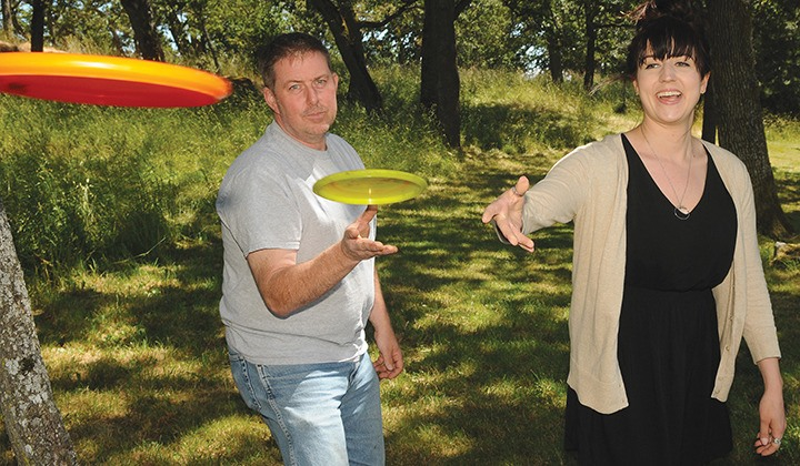 Dan MacDonald, from the South Island Disc Golf Society, throws discs with Monday's Natalie North.