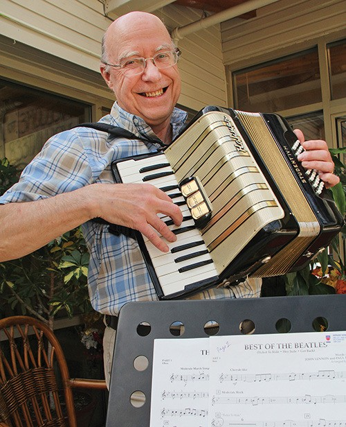 Gerhard Herndler, on the accordion, plays oboe and flute sheet music to fit in with the Monterey Concert Band. He connected with the band after reading a story in the Oak Bay News.