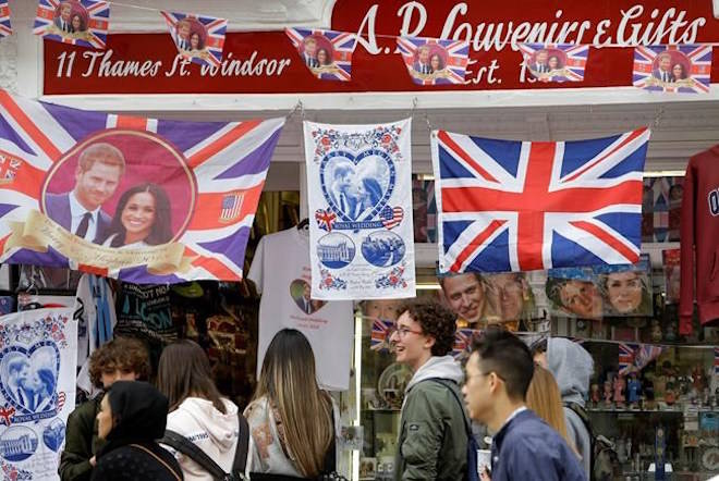 Royal memorabilia on sale near Windsor Castle in Windsor, England, Friday, May 11, 2018. (AP Photo/Alastair Grant)