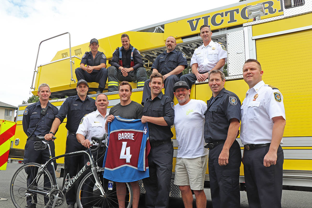 Members of the Victoria Fire Department's Ride to Conquer Cancer team join Colorado Avalanche NHL player Tyson Barrie (front row centre, left) and gold sponsor Jeremy Petzing (third from right), owner of The Local, for the donation of an autographed jersey to be auctioned off at this Friday's Gala for Hope fundraiser at the Crystal Garden. The department team raised approximately $100,000 for the BC Cancer Foundation through its efforts last year. This year's ride goes Aug. 24 and 25 on two routes on the mainland. Don Descoteau/Victoria News