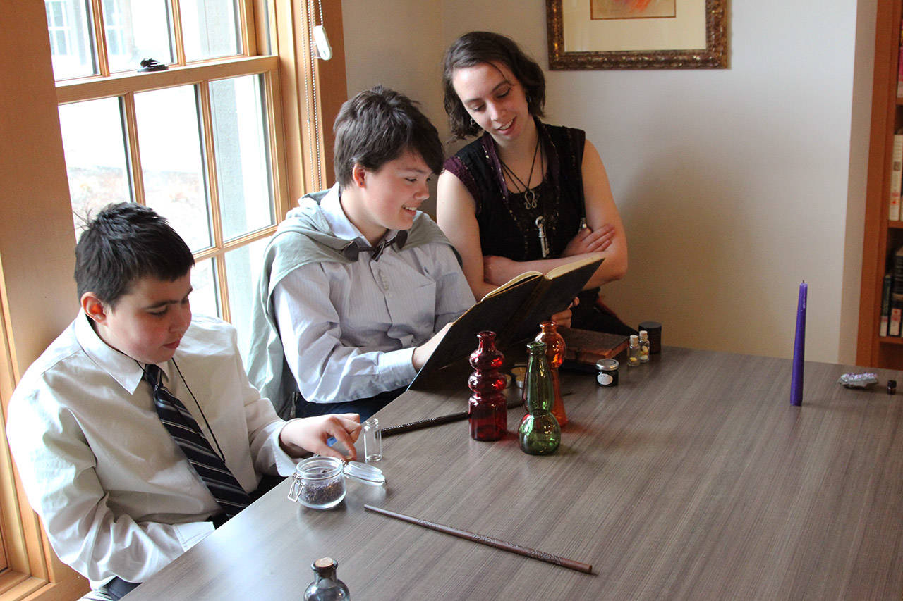 Marcus Asp (left), Olivia French and Thalia Lucie study some spells at the Alectoria School of Magic. (File contributed)