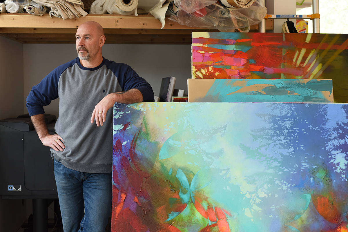 Artist Blu Smith in his North Saanich studio with some of his works. Photo by Don Denton