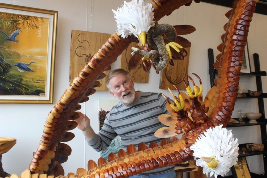 Comox artist Wes Seeley is pictured with his newest creation at Designer Woodworks in Courtenay. Scott Stanfield photo